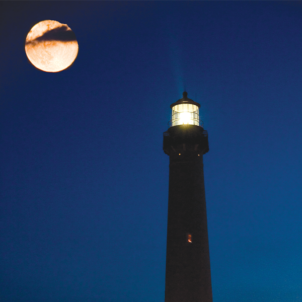 Cape May Lighthouse at night during a full moon