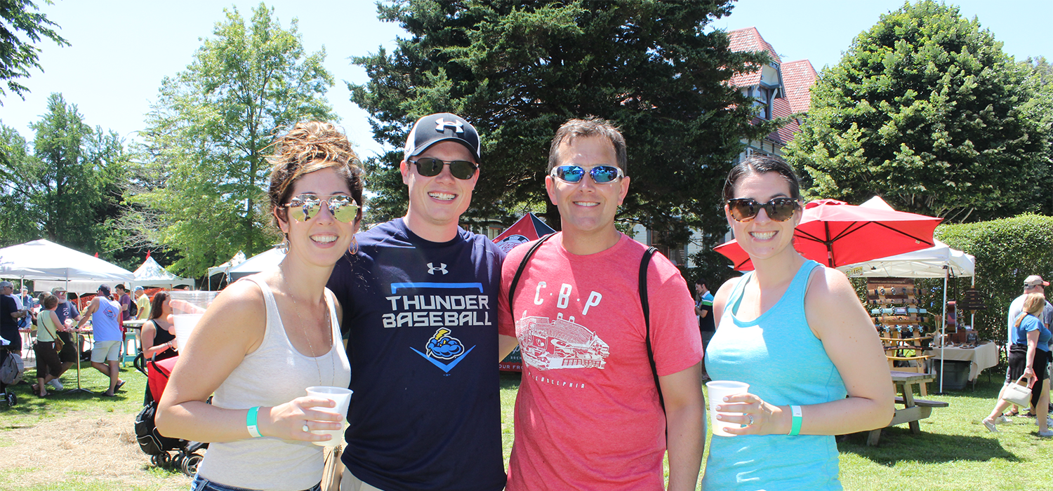 4 friends enjoying beer at the cape may mac Hops Festival