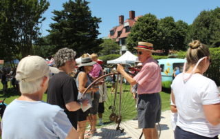 A Tom Carroll showing off his Penny Farthing bike at the cape may mac Hops Festival