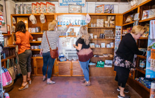 women shopping at the Cape May Lighthouse Museum gift shop