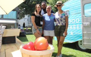 Good house keeping staff posing at their booth at the cape may mac Craft beer, Music & Crab Festival
