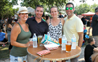4 friends enjoying beer and festival foods at the cape may mac Craft beer, Music & Crab Festival
