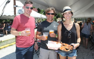 Three adults enjoying beer and crabs at the cape may mac Craft beer, Music & Crab Festival