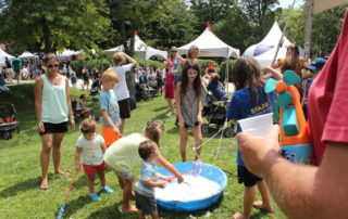 kids playing with bubbles at the kids crafts station at the cape may mac Craft beer, Music & Crab Festival