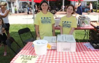 young girl volunteers at the cape may mac Craft beer, Music & Crab Festival