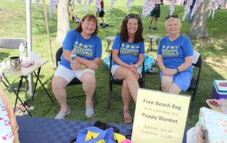 Volunteers at the cape may mac Craft beer, Music & Crab Festival