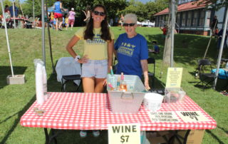 Volunteers serving wine at the cape may mac Craft beer, Music & Crab Festival