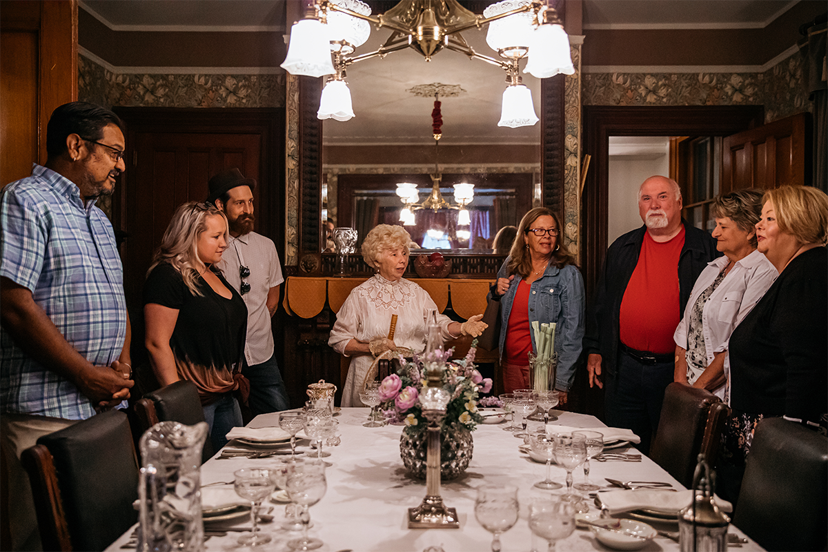 Tour guide giving a tour of emlen physick estate dining room
