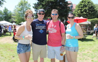 4 friends drinking beer at the cape may mac Hops Festival