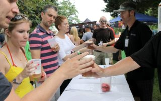 people buying beers at the cape may mac Hops Festival
