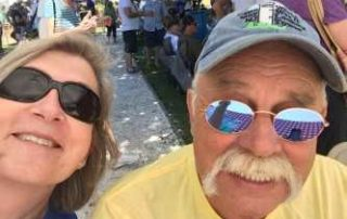 husband and wife taking a selfie at the cape may mac Hops Festival
