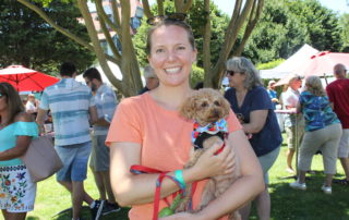 woman with small dog at the cape may mac Hops Festival