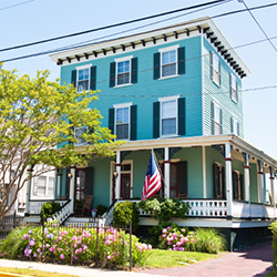 Cape May Cottage Rental, Surfside Cottage, an aqua blue, 3 story home with a wrap around proch