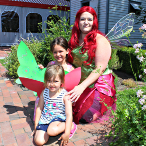 A woman fressed as a fairy wiith two young girls enjoying the Fairy Tale Breakfast at the Emlen PHysick Estate