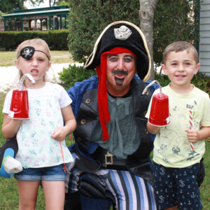two kids and an adults dressed as pirates for the breakfast of pirates at the emlen physick estate