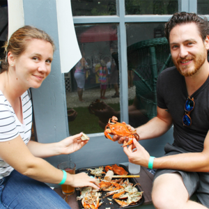 couple enjoying crabs at the cape may mac craft beer, music and crab festival