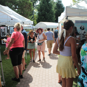 Crowd walking through vendors at a cape may mac festivals event