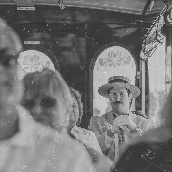 Ghost like photo of victorian man riding trolley