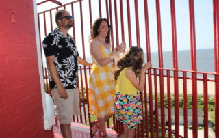 Family at the top of the cape may lighthouse looking at the view