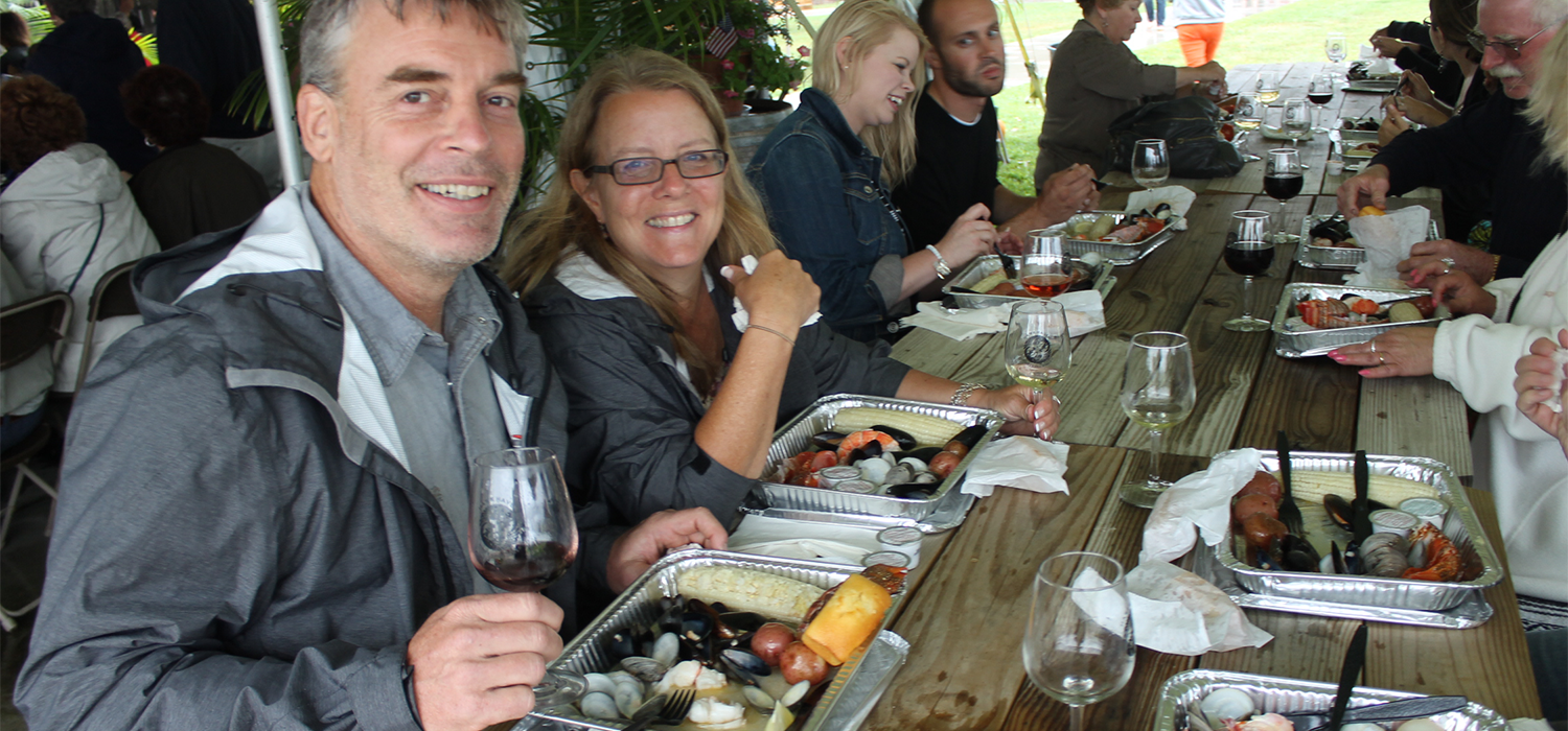 Couple drinking wine and eating clams during the food & wine celebration
