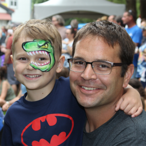 Dad and son with dinosaur facepaint on enjoying the cape may mac hops festivals