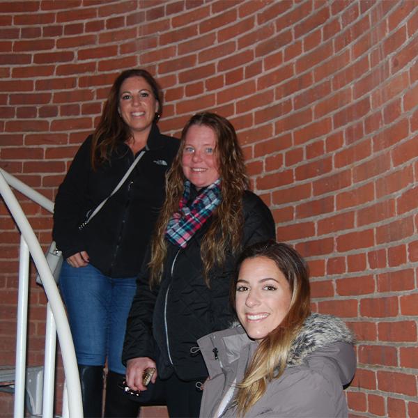 three women enjoying National Lighthouse Day
