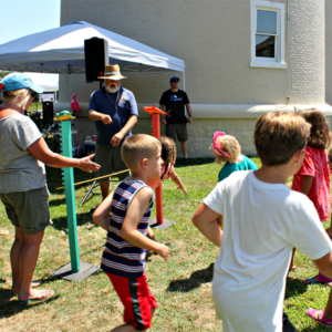 Family fun day at the cape may lighthouse with kids playing games