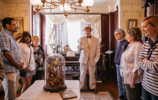 victorian dressed tour guide giving a tour of the emlen physick estate living room