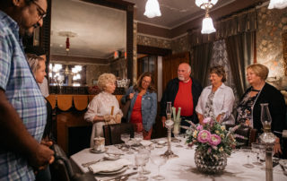 victorian dressed tour guide giving a tour in the emlen physick estate dining room