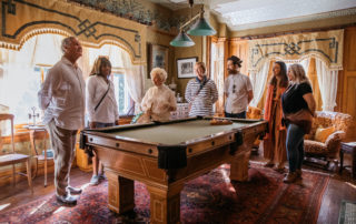 victorian dressed tour guide gives tour of the emlen physick estate billiard room