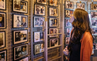 A woman inside the world war ii lookout tower in cape may new jersey looking at photos of world war ii veterans who have died