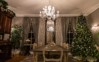 a Beautiful dining room decorate for christmas with a silver sparkle theme