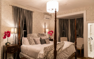 A beautiful upscale bedroom decorate with a silver and white theme