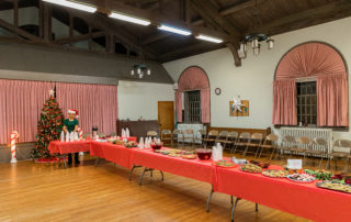 Christmas cookies and drinks set up in a church hall for a big Christmas House Tour event in Cape may