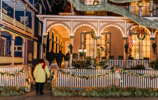 Group of people walking into a victorian house on tour for the CHristmas Candlelight House Tour