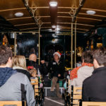 inside a cape may mac trolley filled with people going on tour at night