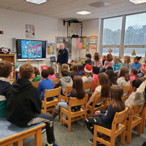 Cape May MAC Museum educator giving a education program to a full classroom of children