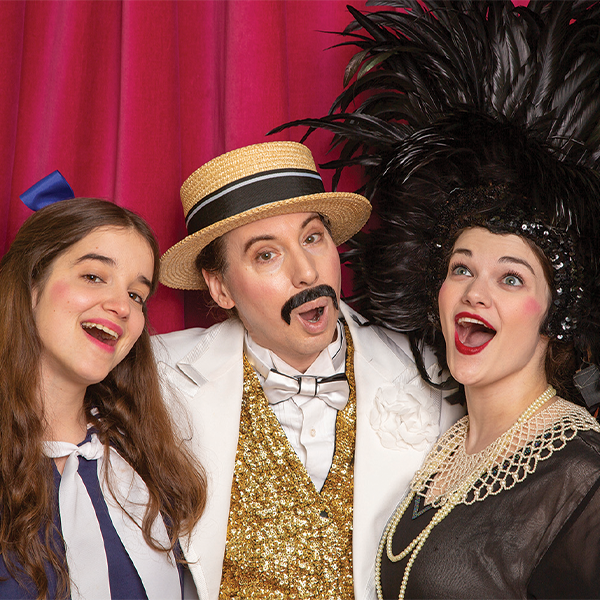 Rev Theatre actors dressed in vaudevillian clothes
