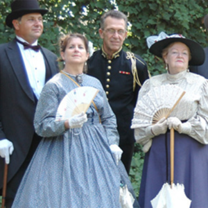 2 men and 2 women dressed in victorian clothes during victorian weekend in cape may