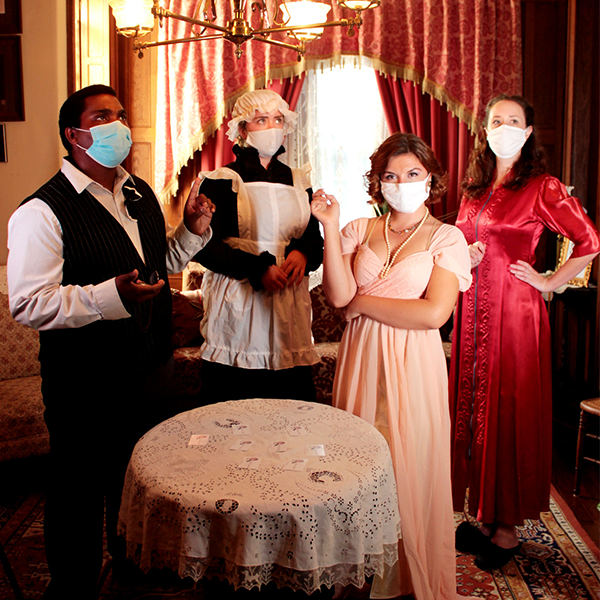 the cast of The Gloomy Apparition, wearing masks