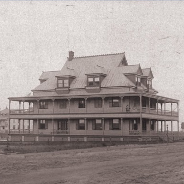 Old black and white photo of the Harrison Cottage in Cape May, New Jersey
