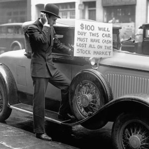 1920s man with sign about stock market crash