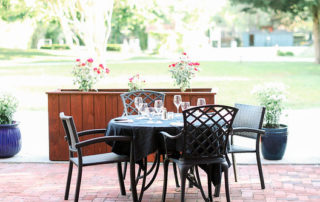 An outdoor restaurant table and chairs