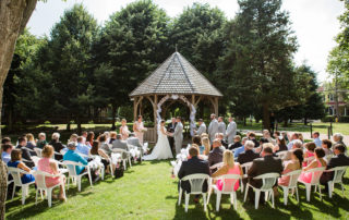 outdoor wedding ceremony in front of a gazebo