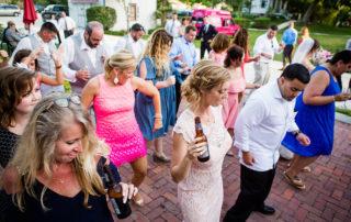 Wedding party dancing on a brick patio