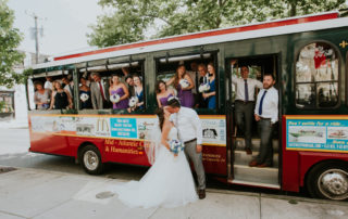 A wedding party on a red trolley