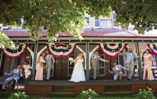 wedding party on the porch of a Victorian house