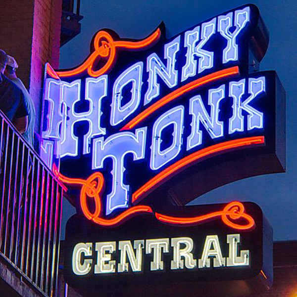 """Photo of a neon sign reading """"honky tonk central"""""""