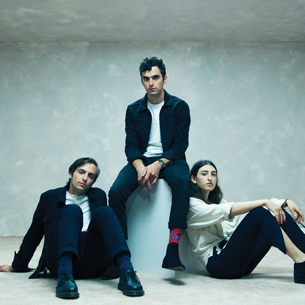 three people sitting in a band